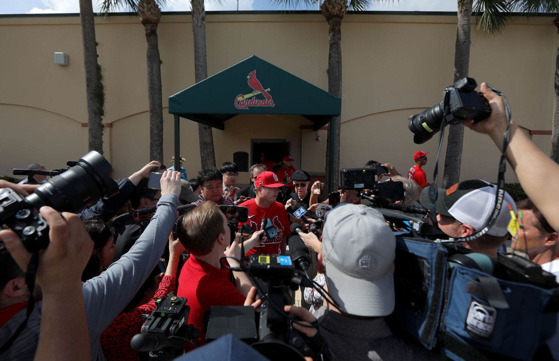 Mike Shildt  talks with media